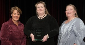 Jennifer Nuttle, Jennifer Lathem and ____ ____ accept the Questionmark Gettings Results Award on behalf of the CareerTech Testing Center(Aaron Clamage Photo)