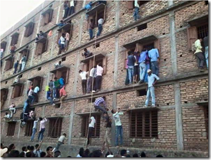 Parents scaling the walls of a building to help their children cheat